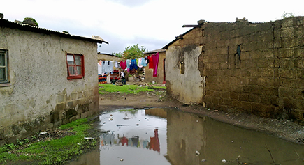 During rainy season this area is flooded, roads are full of ditches with muddy water and pit toilets are flooded with rain water, in Lusaka, Zambia © Sustainable Sanitation Alliance