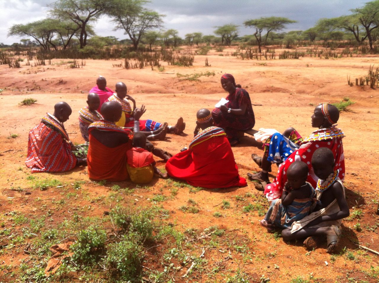 Research assistant, Jaqueline Nalenoi, discussing water security with a group of women in Sessia location, Samburu